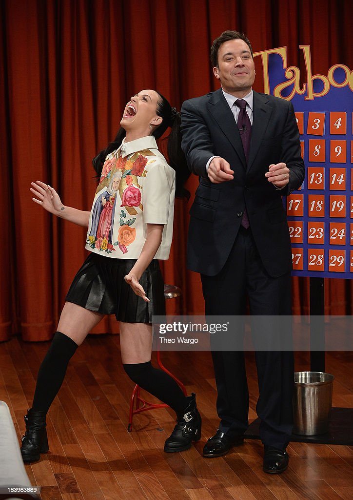 <a gi-track='captionPersonalityLinkClicked' href=/galleries/search?phrase=Katy+Perry&family=editorial&specificpeople=599558 ng-click='$event.stopPropagation()'>Katy Perry</a> and Jimmy Fallon play a game of Taboo during a taping of 'Late Night With Jimmy Fallon' at Rockefeller Center on October 10, 2013 in New York City.