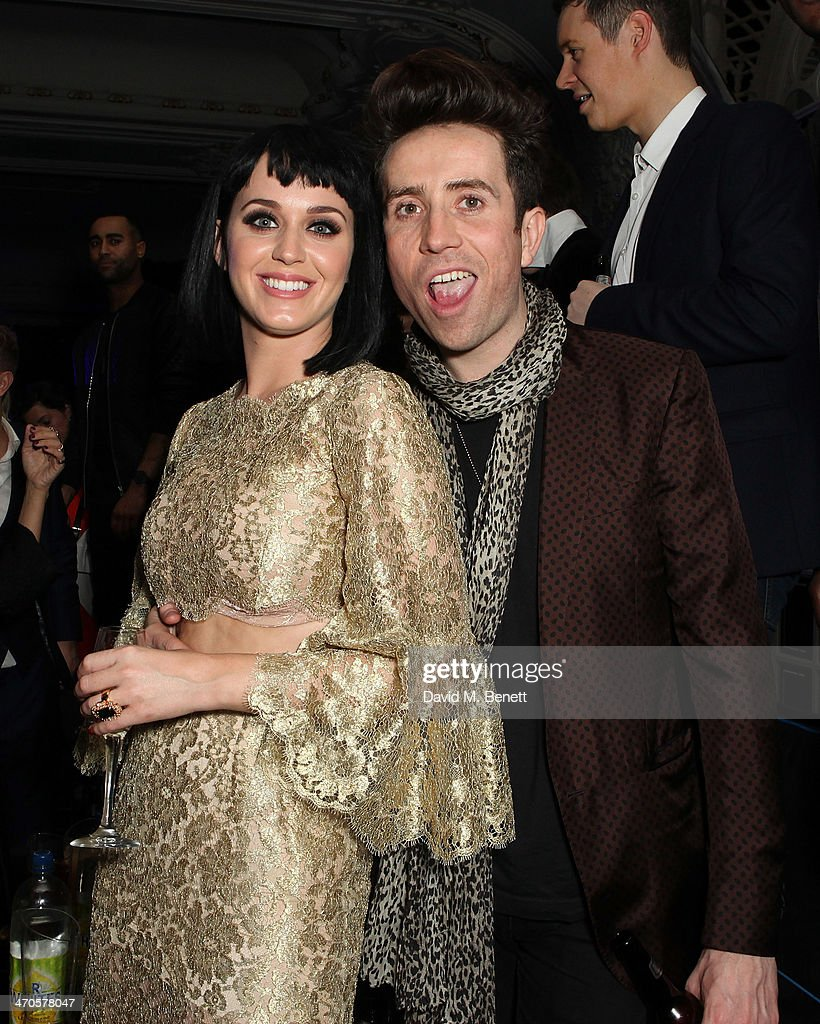 <a gi-track='captionPersonalityLinkClicked' href=/galleries/search?phrase=Katy+Perry&family=editorial&specificpeople=599558 ng-click='$event.stopPropagation()'>Katy Perry</a> and <a gi-track='captionPersonalityLinkClicked' href=/galleries/search?phrase=Nick+Grimshaw&family=editorial&specificpeople=4666727 ng-click='$event.stopPropagation()'>Nick Grimshaw</a> are seen at Warner & Belvedere Post BRIT Awards party at The Savoy Hotel on February 19, 2014 in London, England.