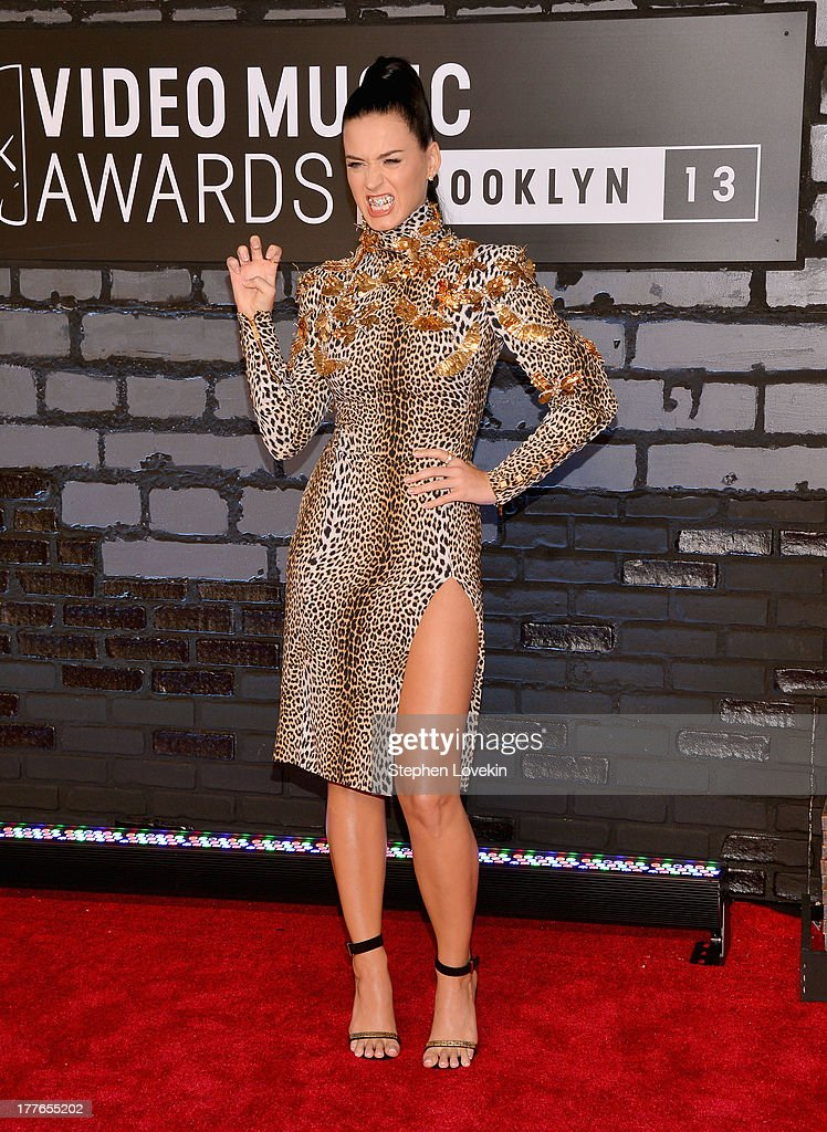 Emanuel Ungaro dress, Anita Ko earrings, Celine shoes)attends the 2013 MTV Video Music Awards at the Barclays Center on August 25, 2013 in the Brooklyn borough of New York City.