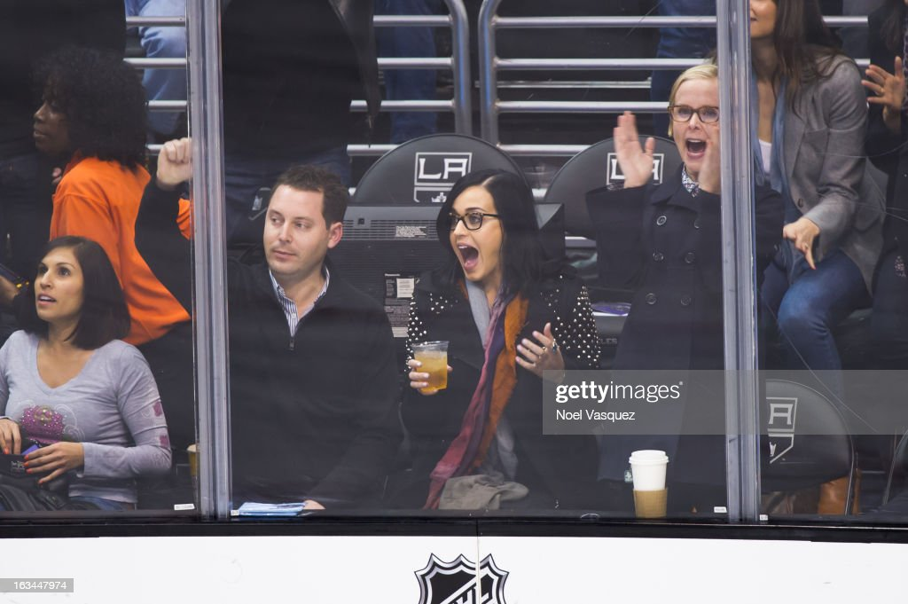 <a gi-track='captionPersonalityLinkClicked' href=/galleries/search?phrase=Katy+Perry&family=editorial&specificpeople=599558 ng-click='$event.stopPropagation()'>Katy Perry</a> celebrates after a goal at a hockey game between the Calgary Flames and Los Angeles Kings at Staples Center on March 9, 2013 in Los Angeles, California.