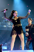 Katy Perry dances as she accepts the Best Female award from RJ Mitte onstage during the MTV EMA's 2013 at the Ziggo Dome on November 10 2013 in...