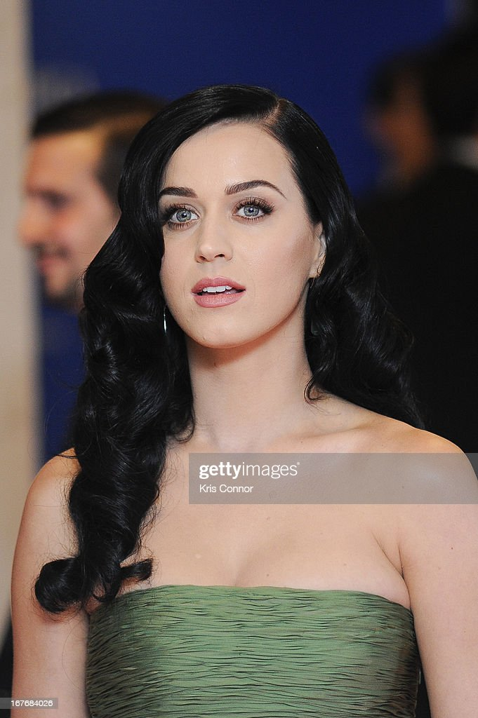 Katy Perry poses during the red carpet at the White House Correspondents' Association Dinner at the Washington Hilton on April 27, 2013 in Washington, DC.