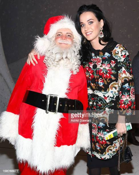 Katy Perry poses for photos with Santa from 'A Christmas Story The Musical' Broadway Performance at LuntFontanne Theatre on December 12 2012 in New...