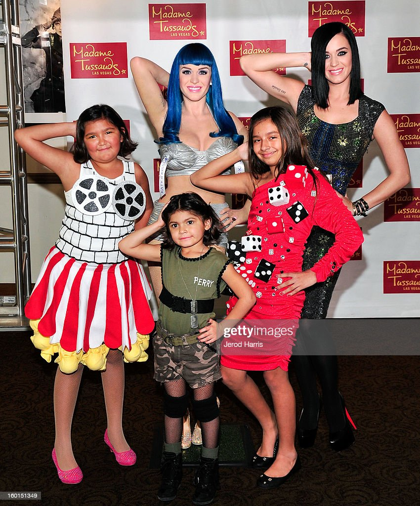 <a gi-track='captionPersonalityLinkClicked' href=/galleries/search?phrase=Katy+Perry&family=editorial&specificpeople=599558 ng-click='$event.stopPropagation()'>Katy Perry</a> (back R) poses with fans as she unveils her wax figure for Madame Tussauds Las Vegas at Paramount Studios on January 26, 2013 in Hollywood, California.