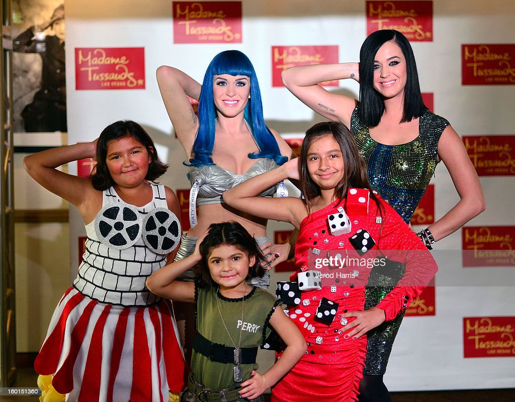 Katy Perry (back R) poses with fans as she unveils her wax figure for Madame Tussauds Las Vegas at Paramount Studios on January 26, 2013 in Hollywood, California.