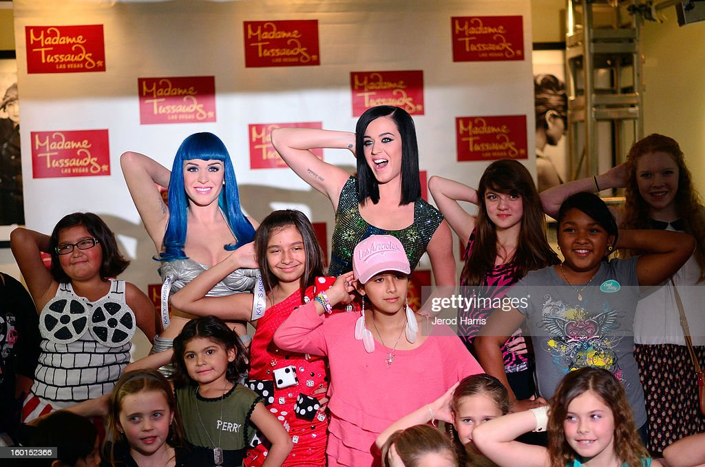 <a gi-track='captionPersonalityLinkClicked' href=/galleries/search?phrase=Katy+Perry&family=editorial&specificpeople=599558 ng-click='$event.stopPropagation()'>Katy Perry</a> (back C) poses with fans as she unveils her wax figure for Madame Tussauds Las Vegas at Paramount Studios on January 26, 2013 in Hollywood, California.