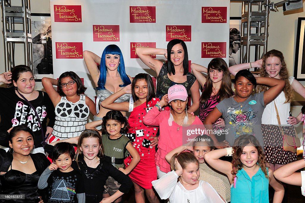 Katy Perry (back C) poses with fans as she unveils her wax figure for Madame Tussauds Las Vegas at Paramount Studios on January 26, 2013 in Hollywood, California.
