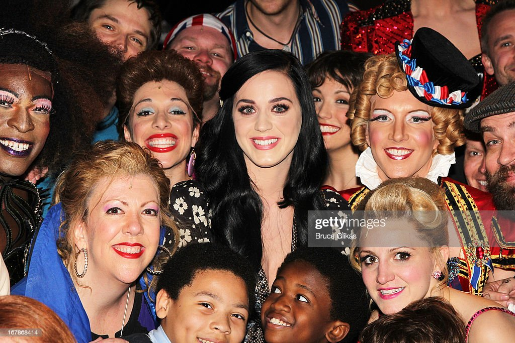 Katy Perry poses with the cast backstage at the Tony Nominated hit musical 'Kinky Boots' on Broadway at The Al Hirshfeld Theater on May 1, 2013 in New York City.