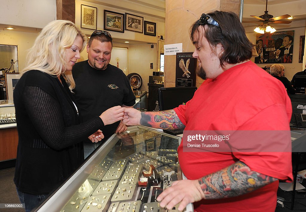 Katy Rygaard and 'Ax Men' Gabe Rygaard purchase a ring from 'Pawn Stars' Austin 'Chumlee' Russell at Gold and Silver Pawn on April 7, 2010 in Las Vegas, Nevada.