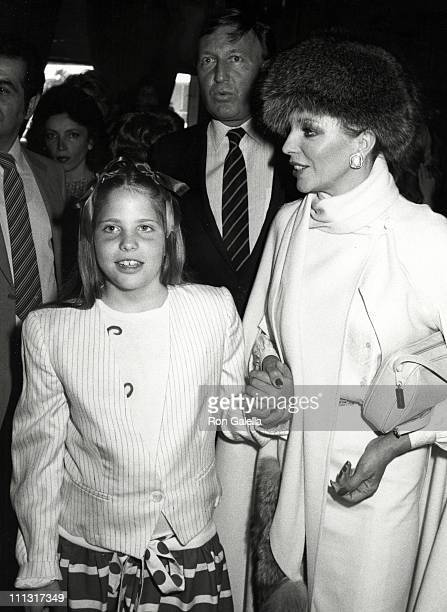 Katyanna Kass Ron Kass and Joan Collins during 1983 Young Musicians Annual Celebrity Mother Daughter Fashion Show Luncheon at Beverly Hilton Hotel in...