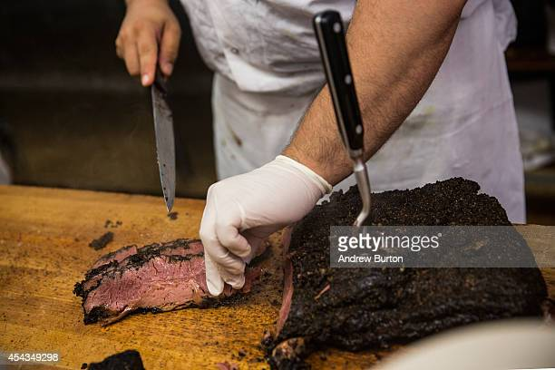 Katz's Deli employee makes a pastrami on rye sandwich on August 29 2014 in New York City The iconic New York deli recently sold the air rights to...