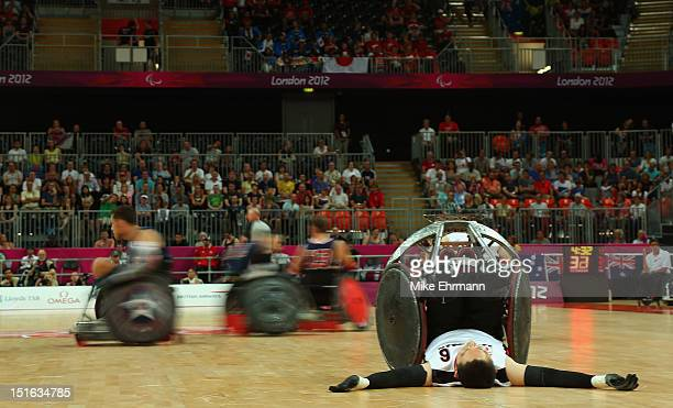 Kauhiko Kanno o Japan tips over during the Bronze Medal match of Mixed Wheelchair Rugby against the United States on day 11 of the London 2012...