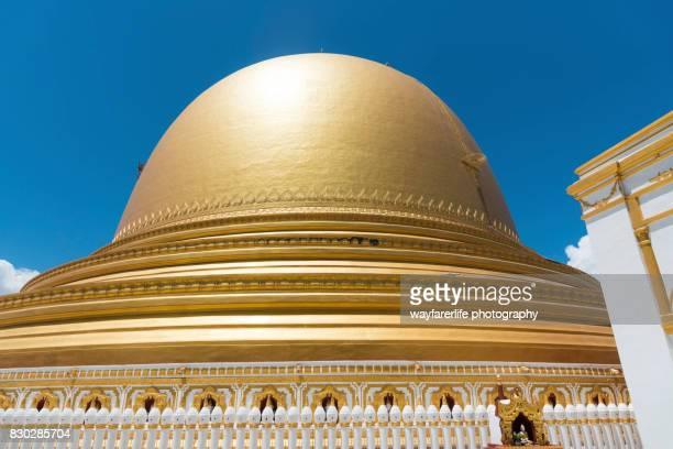 Kaunghmudaw Pagoda, a golden colored pagoda again blue sky, Myanmar