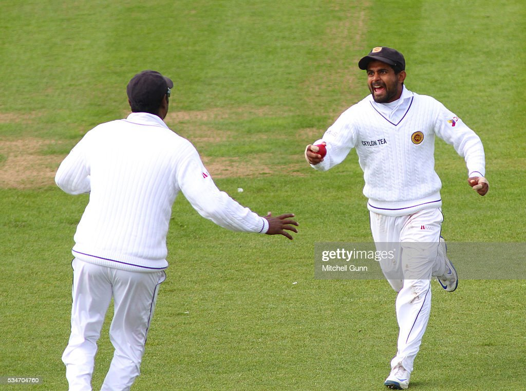 Kaushal Silva of Sri Lanka celebrates catching the ball to dismiss Joe Root of England during day one of the 2nd Investec Test match between England and Sri Lanka at Emirates Durham ICG on May 27, 2016 in Chester-le-Street, United Kingdom.
