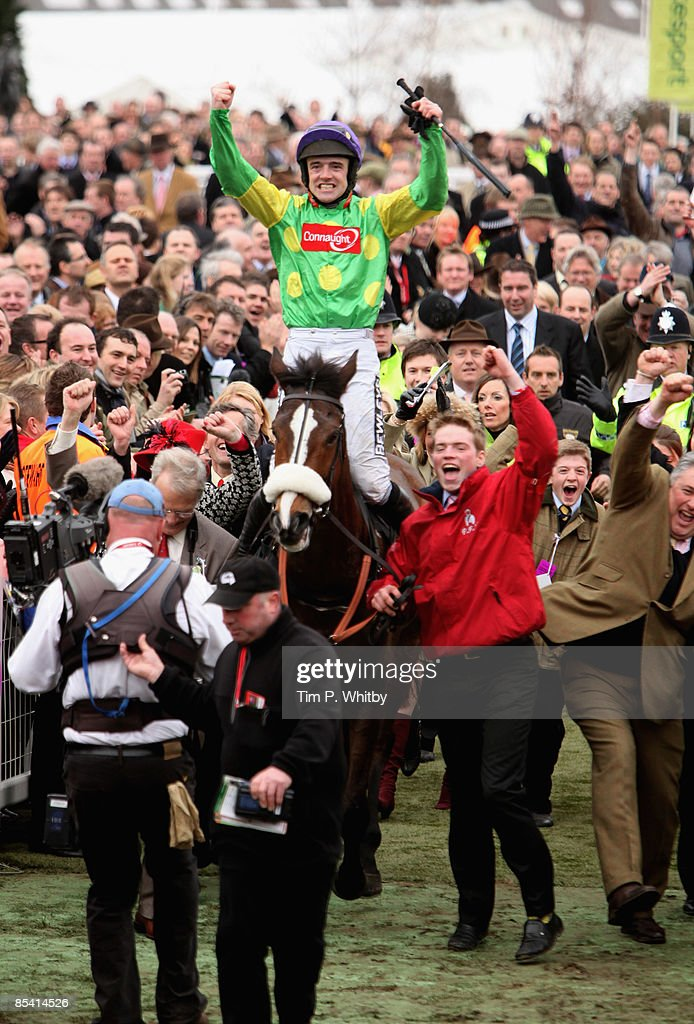 Kauto Star ridden by jockey Ruby Walsh arrives in the winners paddock after winning the Cheltenham Gold Cup at Cheltenahm race course on March 13, 2009 In Cheltemhan, England.