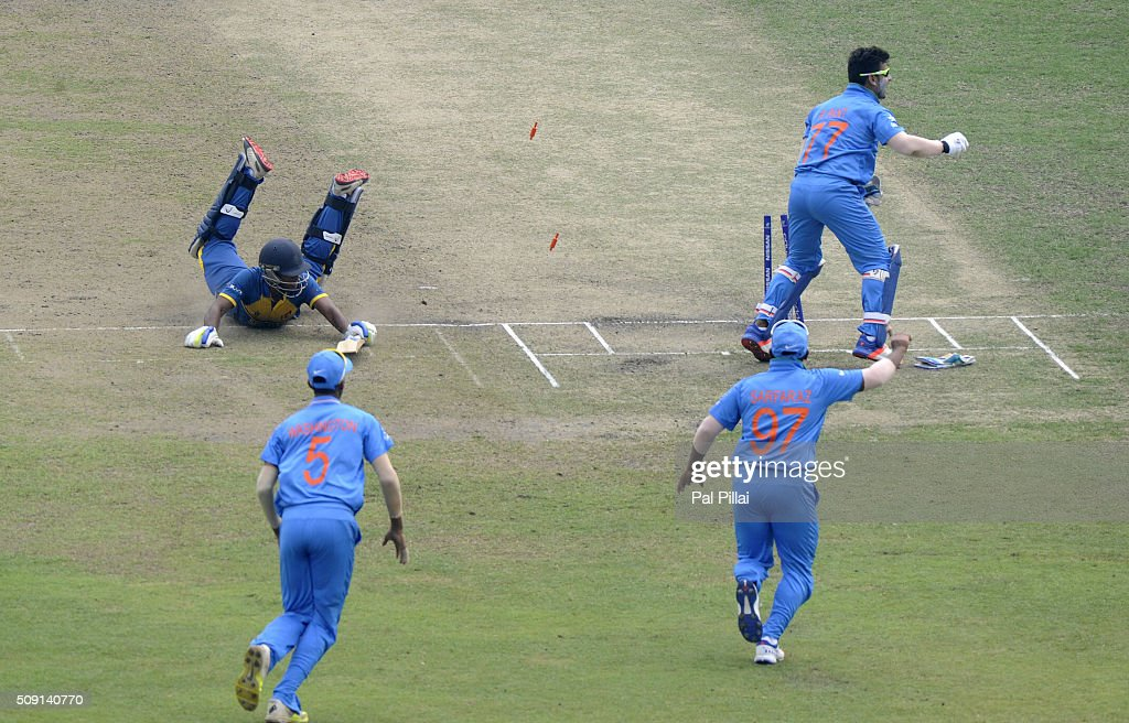 Kaveen Bandara of Sri Lanka gets run out by Rishabh Pant of India during the ICC U19 World Cup Semi-Final match between India and Sri Lanka on February 9, 2016 in Dhaka, Bangladesh.