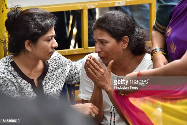 Kavita sister of the slain journalist Gauri Lankesh cries as her mortal remains are kept at Town Hall on September 6 2017 in Bengaluru India Protests...