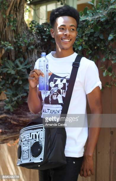 Ka'von Fair pose for portrait with CBD Water and Fydelity Le Boom Box GFORCE Shoulder Bag at TAP The Artists Project Style House on October 4 2017 in...