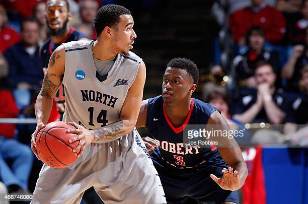 Kavon Stewart of the Robert Morris Colonials defends against Dallas Moore of the North Florida Ospreys during the first round of the 2015 NCAA Men's...