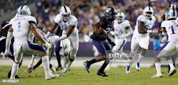 KaVontae Turpin of the TCU Horned Frogs carries the ball against the Kansas Jayhawks in the first half at Amon G Carter Stadium on October 21 2017 in...