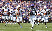 KaVontae Turpin of the TCU Horned Frogs carries the ball for a touchdown against Duke Thomas of the Texas Longhorns Dylan Haines of the Texas...
