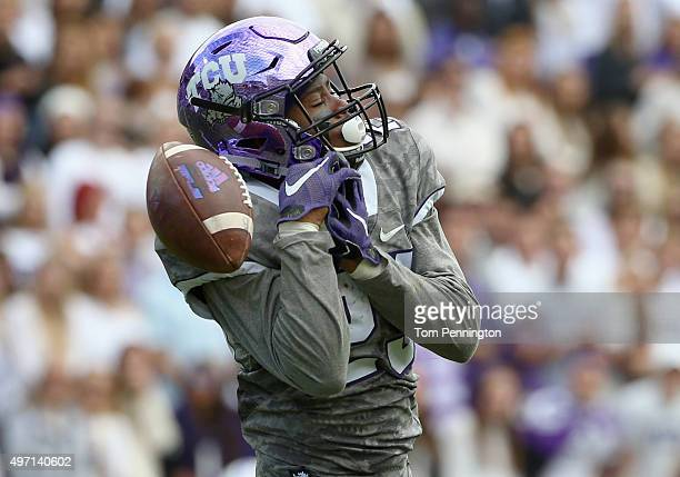 KaVontae Turpin of the TCU Horned Frogs drops a punt return against the Kansas Jayhawks in the second quarter at Amon G Carter Stadium on November 14...