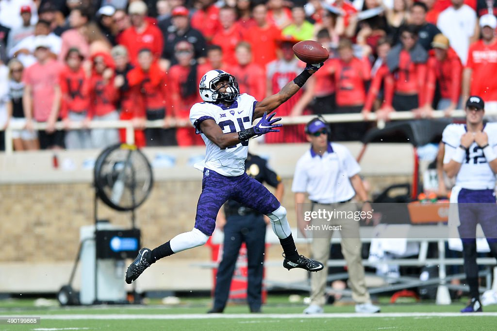 KaVontae Turpin of the TCU Horned Frogs makes a one handed catch against the Texas Tech Red Raiders on September 26 2015 at Jones ATT Stadium in...