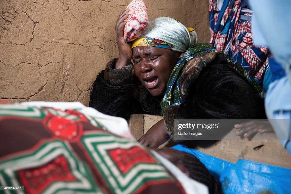 Kavuo Paskalini mourns for Lea Kisuki who was killed by a machete blow during an attack on December 2 2014 in Beni Democratic Republic of Congo A...