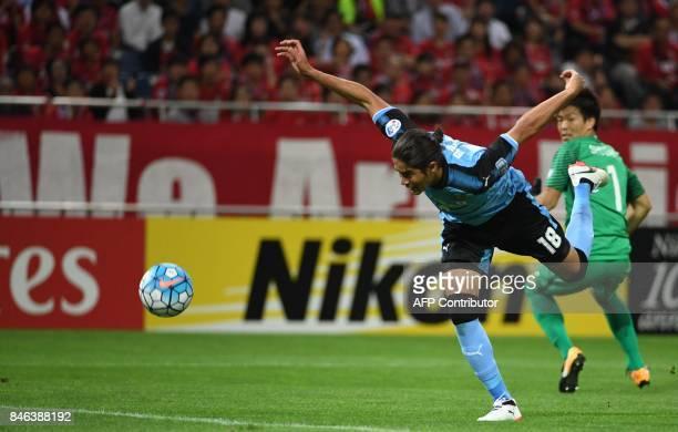 Kawasaki Frontale defender Elsinho shoots past Japan's Urawa Reds goalkeeper Shusaku Nishikawa to score during the AFC Champions League quarterfinal...