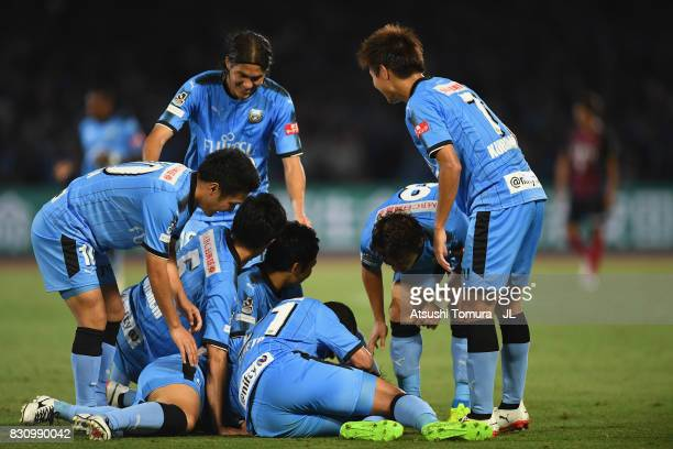 Kawasaki Frontale players congratulate Akihiro Ienaga after scoring his side's third goal during the JLeague J1 match between Kawasaki Frontale and...