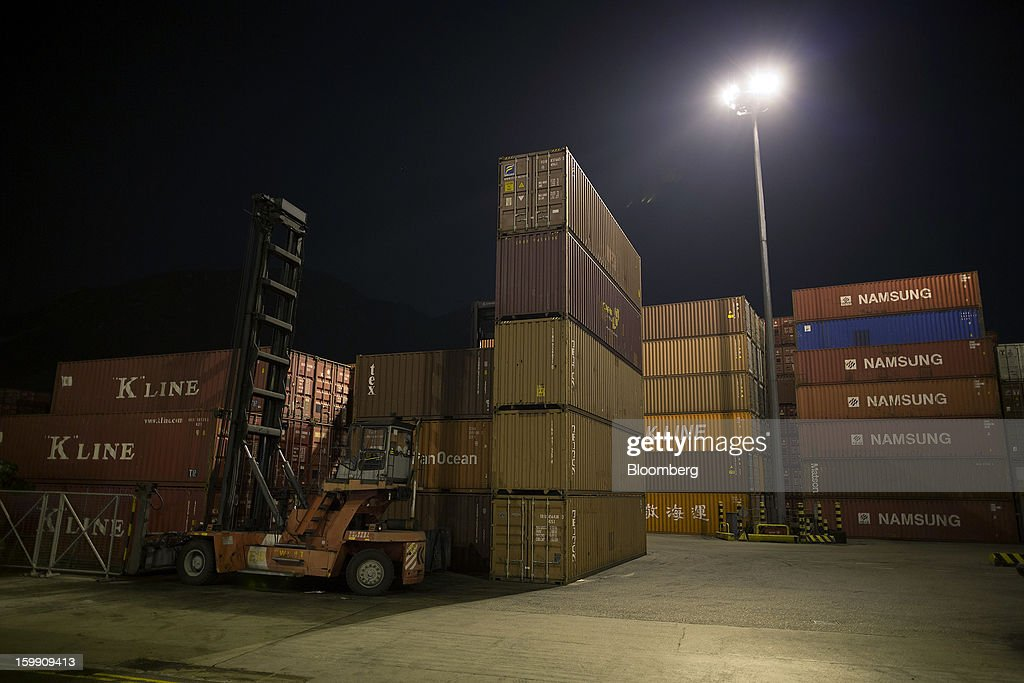 Kawasaki Kisen Kaisha Ltd. 'K' Line, left, and Namsung shipping containers stand stacked with others at night in the Kwai Tsing Container Terminals in Hong Kong, China, on Tuesday, Jan. 22, 2013. Hong Kong is scheduled to release export figures for December on Jan. 24. Photographer: Jerome Favre/Bloomberg via Getty Images