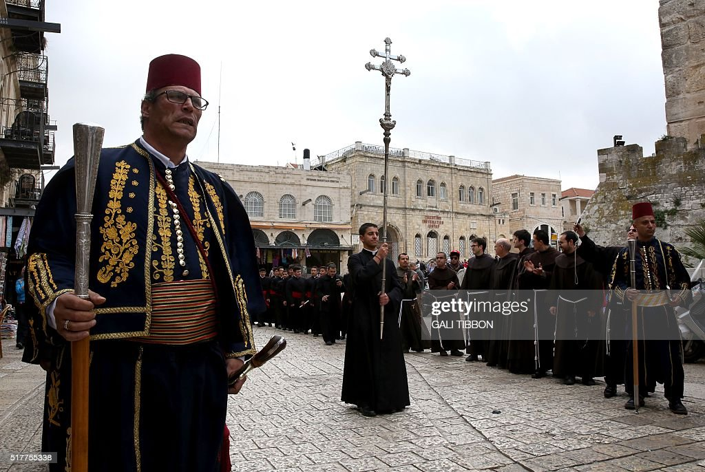 Kawases in traditional Ottoman outfits lead a procession of Roman Catholic clergymen on Easter Sunday from the Church of the Holy Sepulchre through...