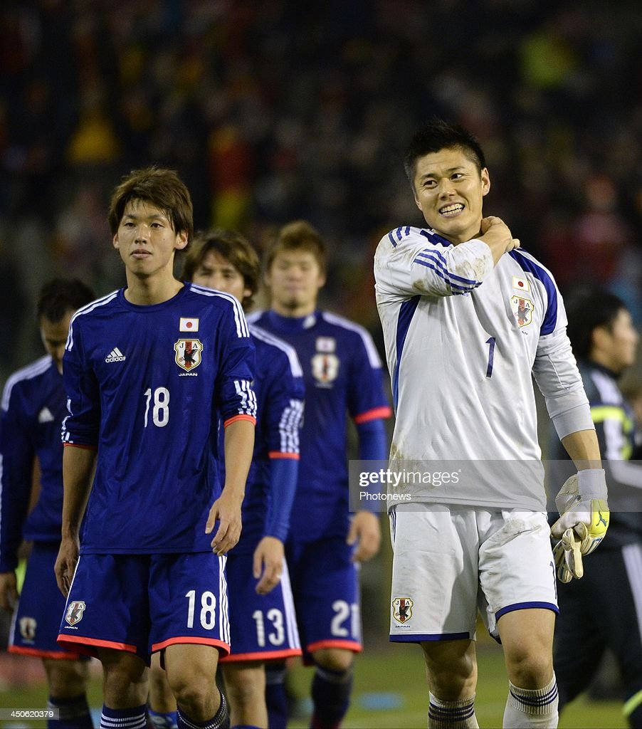 Kawashima of Japan celebrates the win with teammates pictured during the international friendly match before the World Cup in Brasil between Belgium and Japan on November 19, 2013 in Brussels, Belgium