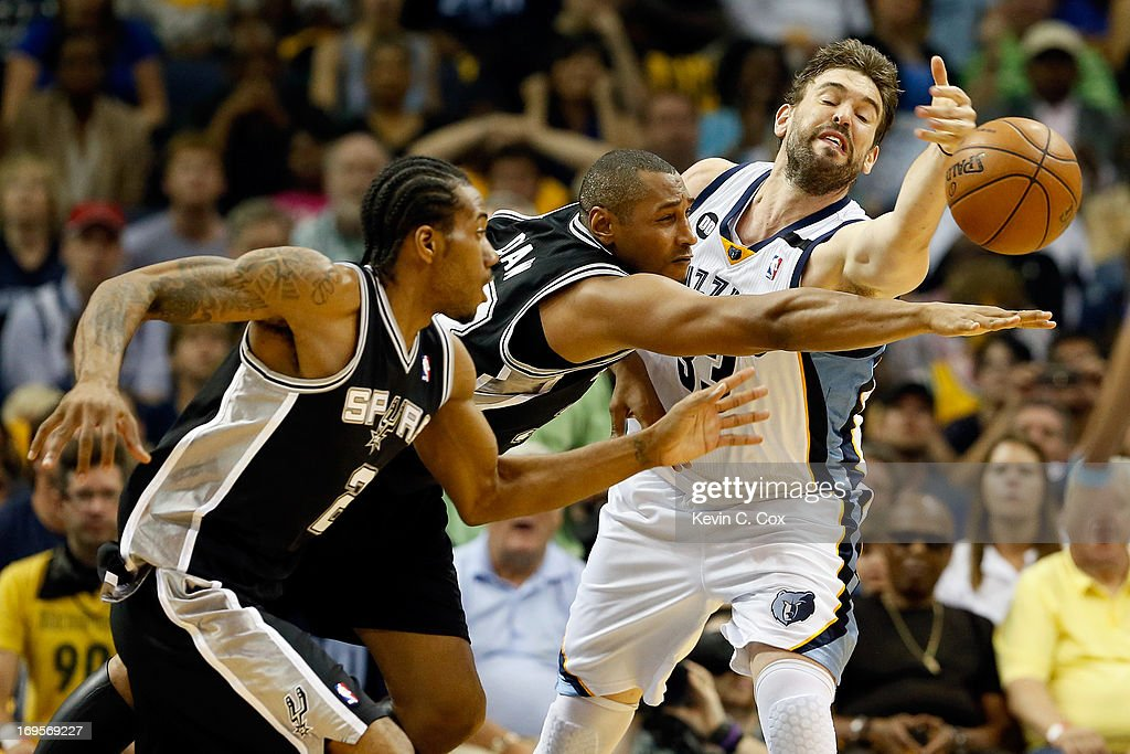 Kawhi Leonard #2 and Boris Diaw #33 of the San Antonio Spurs go after the ball against Marc Gasol #33 of the Memphis Grizzlies in the second quarter during Game Four of the Western Conference Finals of the 2013 NBA Playoffs at the FedExForum on May 27, 2013 in Memphis, Tennessee.