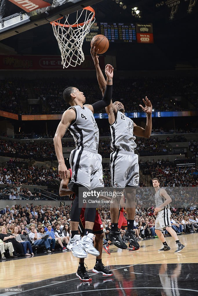 <a gi-track='captionPersonalityLinkClicked' href=/galleries/search?phrase=Kawhi+Leonard&family=editorial&specificpeople=6691012 ng-click='$event.stopPropagation()'>Kawhi Leonard</a> #2 and Danny Green #4 of the San Antonio Spurs go up for a rebound against the Miami Heat on March 31, 2013 at the AT&T Center in San Antonio, Texas.