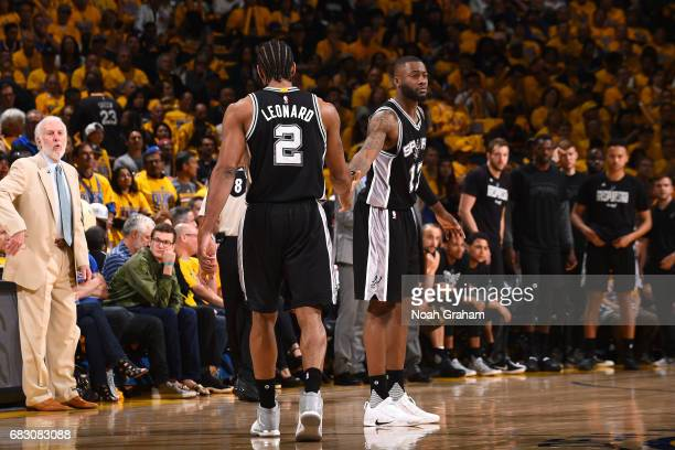 Kawhi Leonard and Jonathon Simmons of the San Antonio Spurs high five each other during the game against the Golden State Warriors during Game One of...