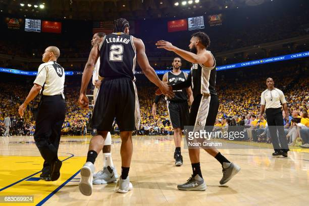 Kawhi Leonard and Patty Mills of the San Antonio Spurs high five each other during the game against the Golden State Warriors during Game One of the...