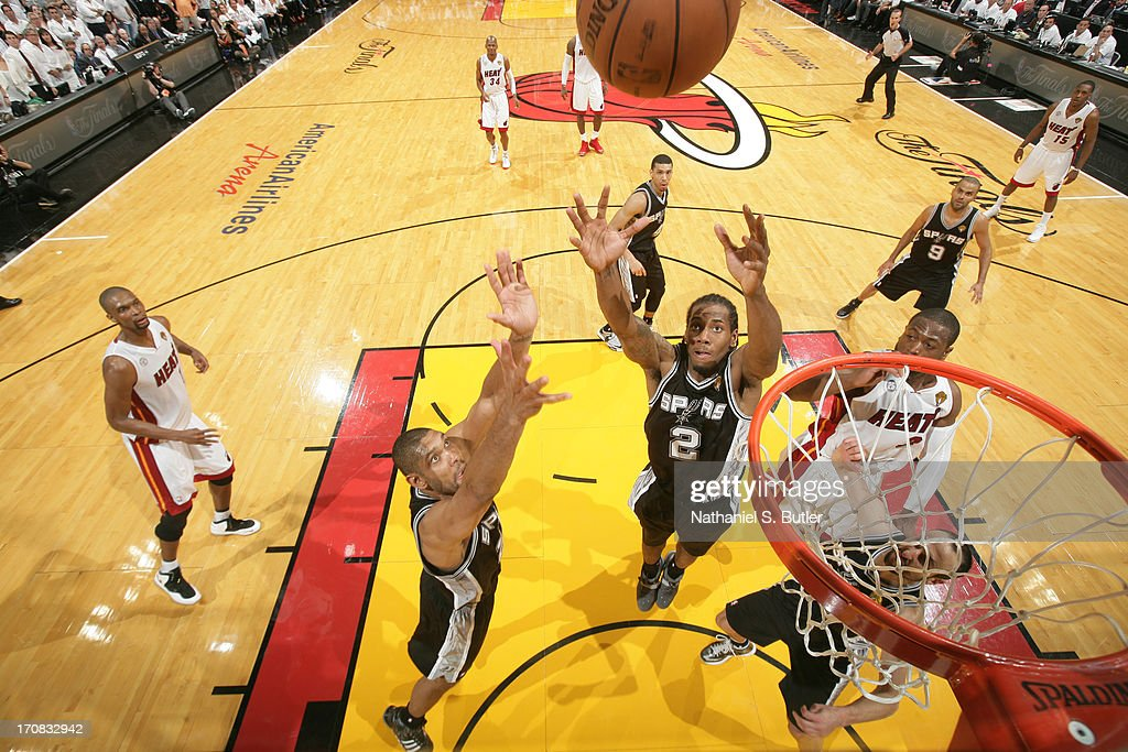Kawhi Leonard #2 and Tim Duncan #21 of the San Antonio Spurs rebounds against the Miami Heat during Game Six of the 2013 NBA Finals on June 18, 2013 at American Airlines Arena in Miami, Florida.