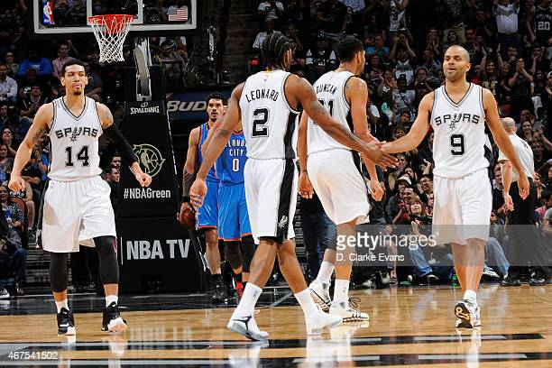 Kawhi Leonard and Tony Parker of the San Antonio Spurs during the game against the Oklahoma City Thunder at the ATT Center on March 25 2014 in San...