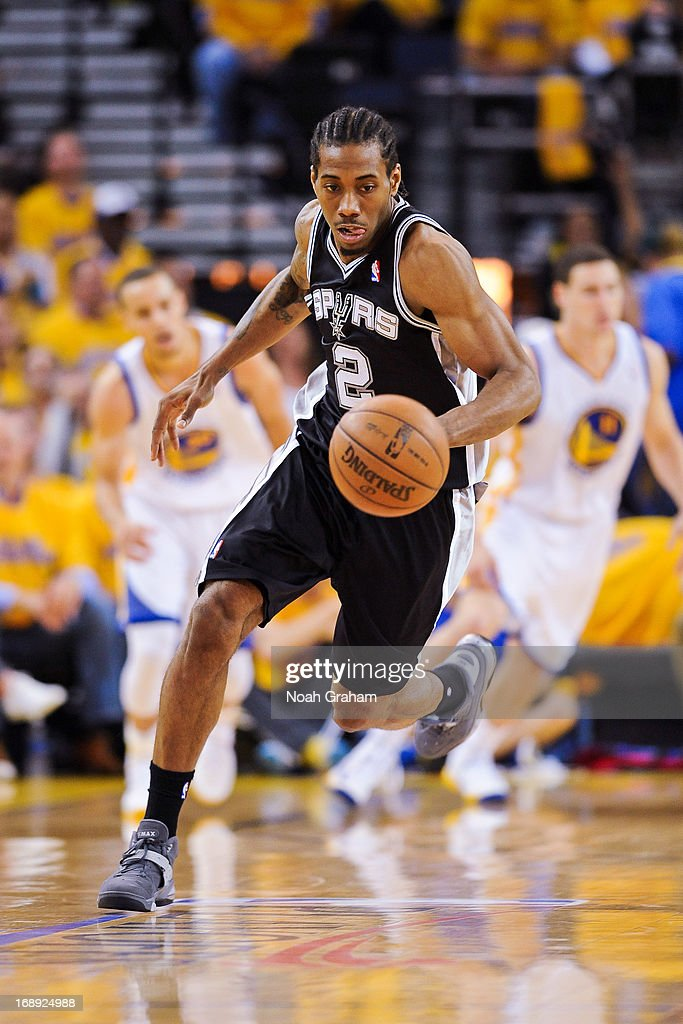 Kawhi Leonard #2 of the San Antonio Spurs advances the ball against the Golden State Warriors in Game Six of the Western Conference Semifinals during the 2013 NBA Playoffs on May 16, 2013 at Oracle Arena in Oakland, California.