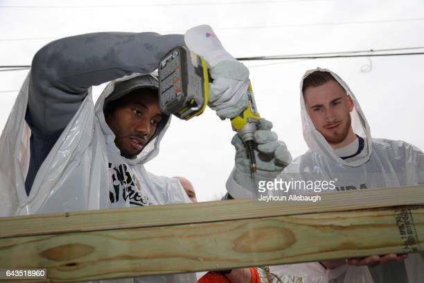 Kawhi Leonard of the San Antonio Spurs and Gordon Hayward of the Utah Jazz participate during the NBA Cares Day of Service as part of 2017 AllStar...