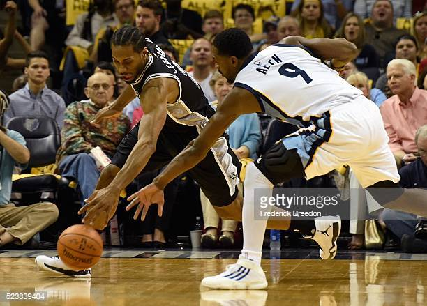 Kawhi Leonard of the San Antonio Spurs and Tony Allen of the Memphis Grizzlies chase a loose ball during the first half of Game Four of the First...