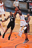 Kawhi Leonard of the San Antonio Spurs blocks a dunk attempt by Eric Bledsoe of the Phoenix Suns on February 28 2015 at US Airways Center in Phoenix...