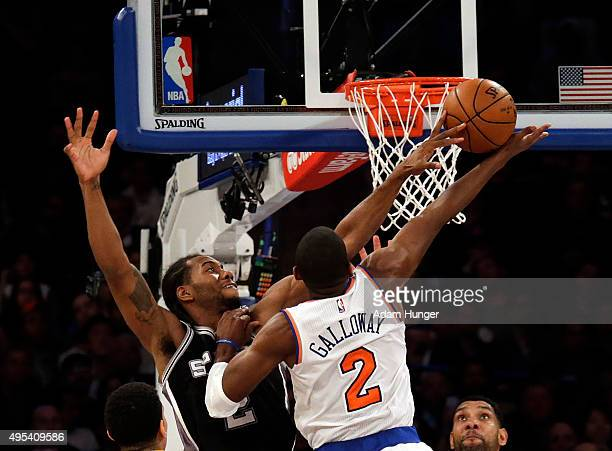 Kawhi Leonard of the San Antonio Spurs blocks a shot by Langston Galloway of the New York Knicks during the second half at Madison Square Garden on...