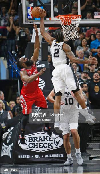 Kawhi Leonard of the San Antonio Spurs blocks shot attempt by James Harden of the Houston Rockets that would have tied the score in closing seconds...