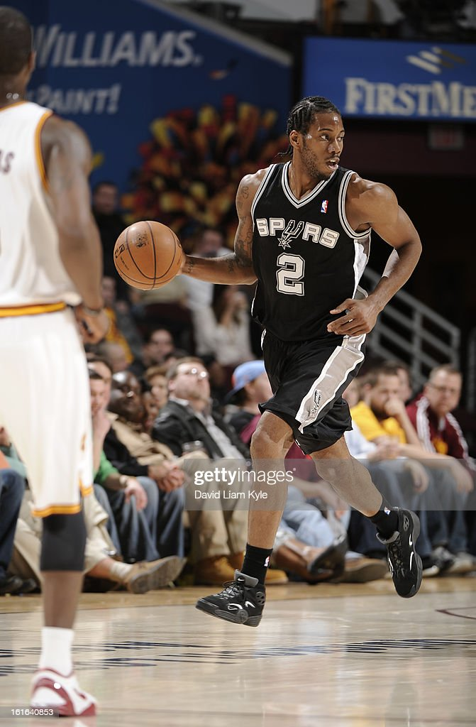 Kawhi Leonard #2 of the San Antonio Spurs brings the ball up the court against the Cleveland Cavaliers at The Quicken Loans Arena on February 13, 2013 in Cleveland, Ohio.