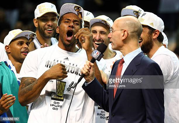 Kawhi Leonard of the San Antonio Spurs celebrates after being named the MVP following Game Five of the 2014 NBA Finals against the Miami Heat at the...
