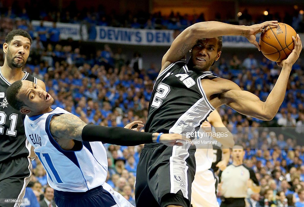 Kawhi Leonard #2 of the San Antonio Spurs dribbles against Monta Ellis #11 of the Dallas Mavericks in Game Four of the Western Conference Quarterfinals during the 2014 NBA Playoffs at American Airlines Center on April 28, 2014 in Dallas, Texas.