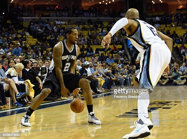 Kawhi Leonard of the San Antonio Spurs dribbles against Vince Carter of the Memphis Grizzlies during the first half of Game Four of the First Round...