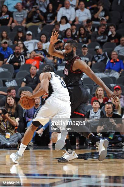 Kawhi Leonard of the San Antonio Spurs dribbles the ball while guarded by James Harden of the Houston Rockets in Game Five of the Western Conference...